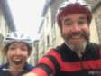 Riding through Bourg d'Oisans with a fellow guide.