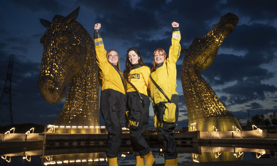 Members of the Queensferry crew help launch the RNLI's 2019 Mayday campaign in front of The Kelpies, Falkirk.  The landmarks which are lit the same colour as the charity's iconic uniforms will light up throughout the month of May to help spread awareness of the lifesaving work of RNLI's volunteer crews, inspire people to get involved and help save lives at sea.