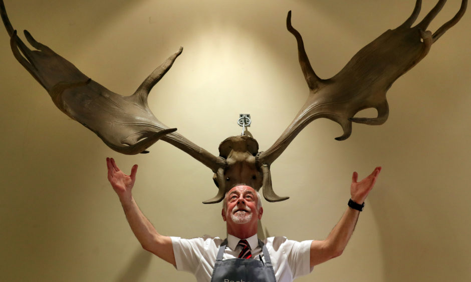 Danny McIlwraith from Bonhams with a pair of Irish Elk or Giant Deer antlers valued between £26000-£30000 which are part of Bonhams Sporting sale which took place on May 1 in Edinburgh. The antlers once belonged to the world-renowned Australian painter, Sir Sydney Nolan, famous for his depiction of the outlaw Ned Kelly.