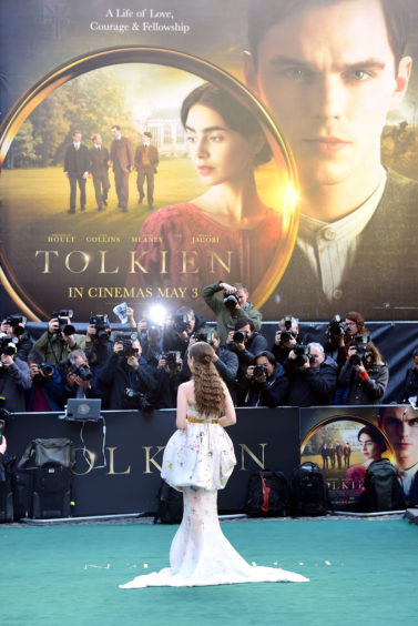 Lily Collins attending the UK premiere of Tolkien held at Curzon Mayfair, London .