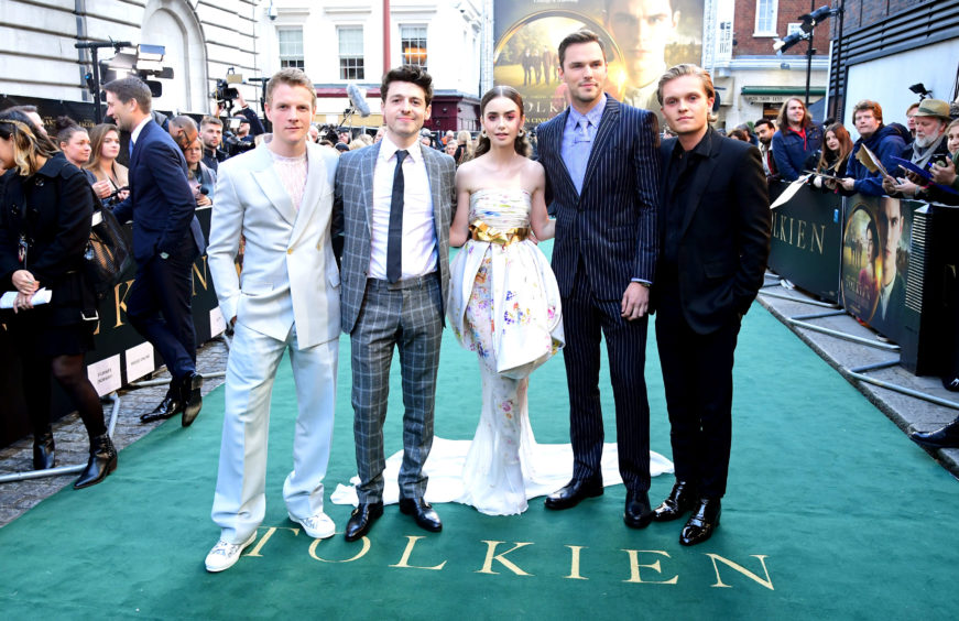 Patrick Gibson (left), Anthony Boyle, Lily Collins, Nicholas Hoult, and Tom Glynn-Carney attending the UK premiere of Tolkien held at Curzon Mayfair, London .