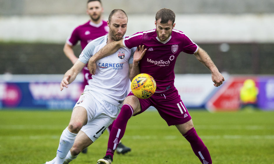 Danny Denholm (right) going up against Montrose's Sean Dillon in his Arbroath days.