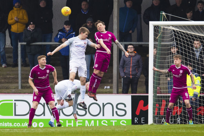 Arbroath's Ricky Little (R) in action with Montrose's Jamie Redman.