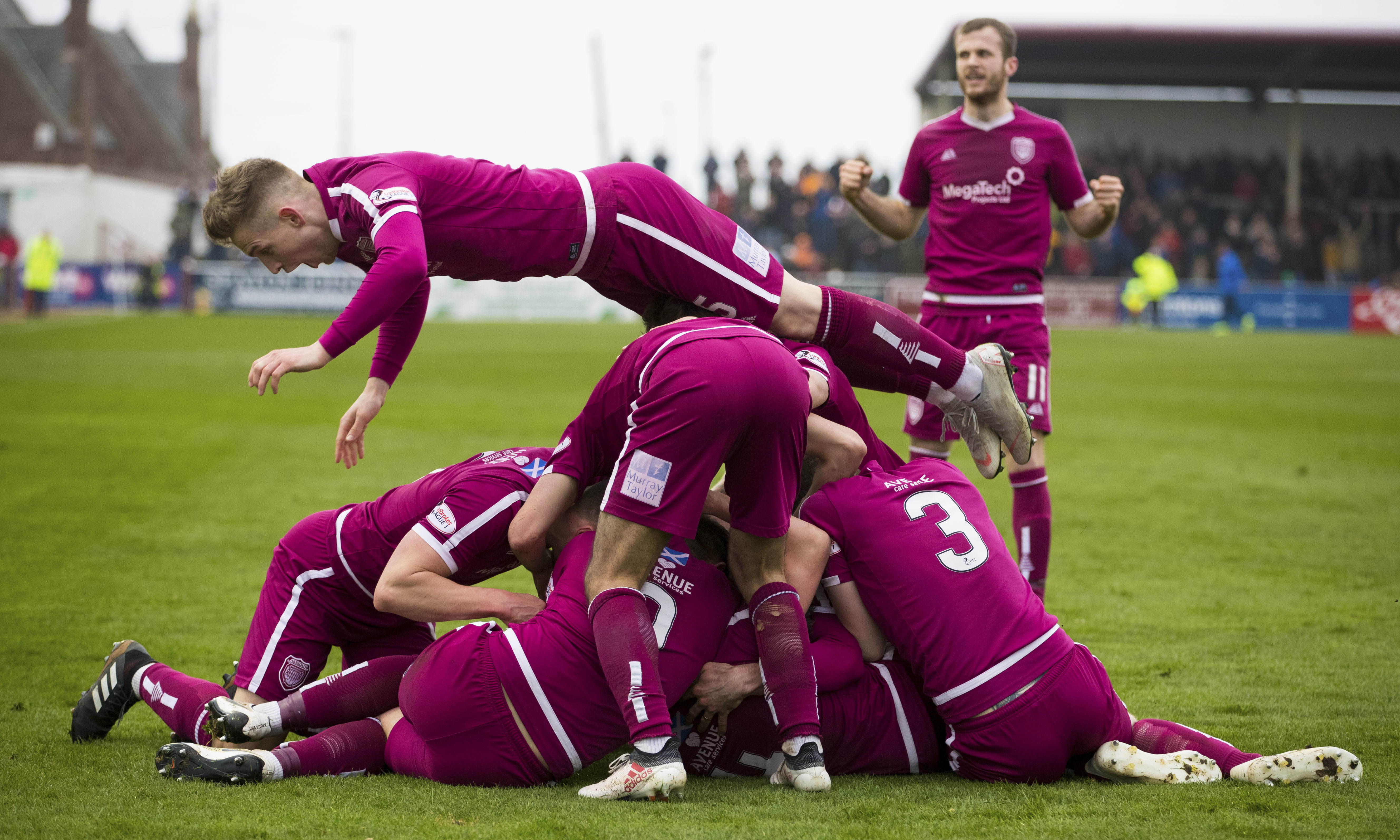 Arbroath players celebrate.