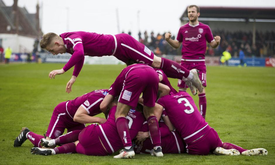The Arbroath players celebrate Ricky Little's goal.