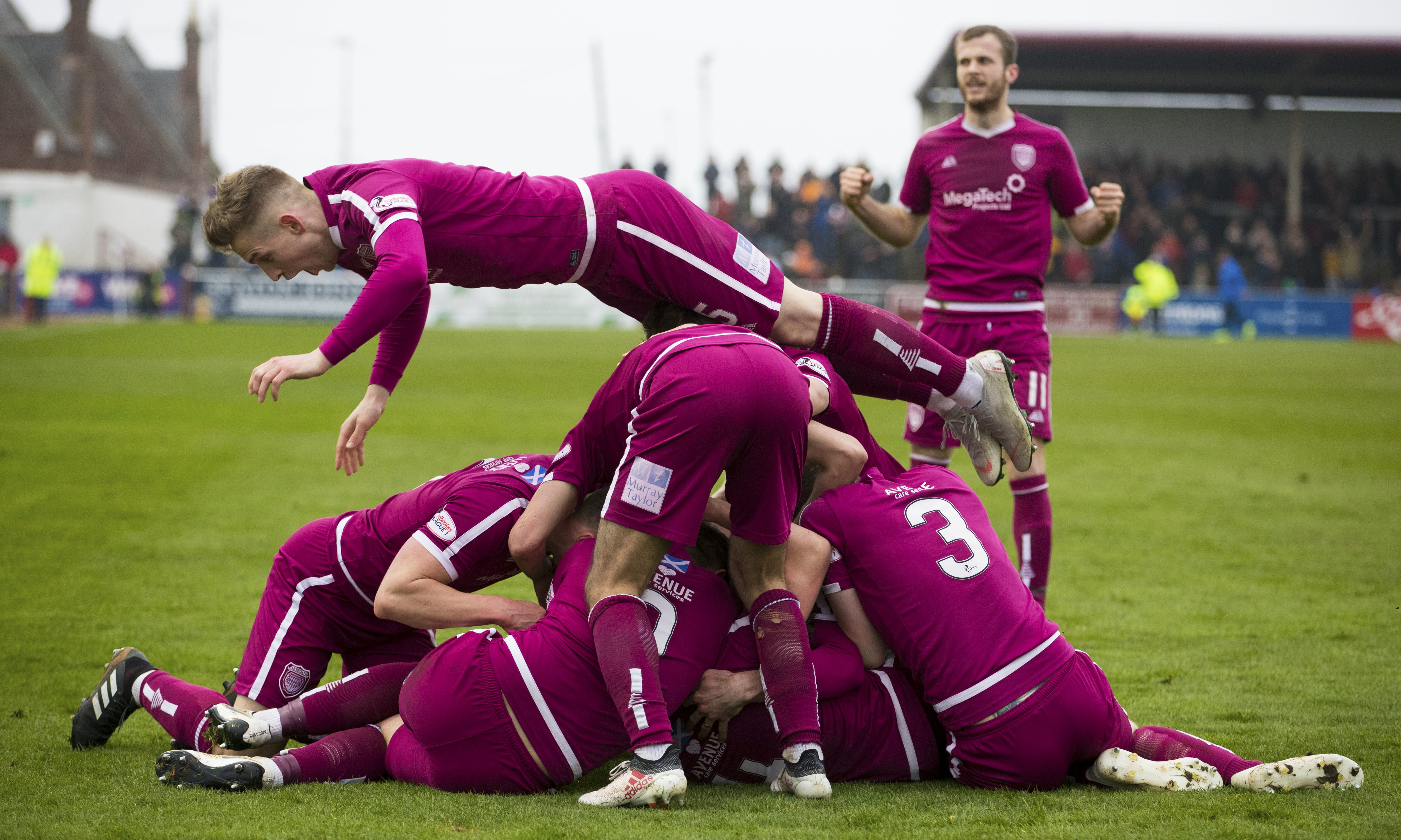 The Arbroath players celebrate Ricky Little's goal.