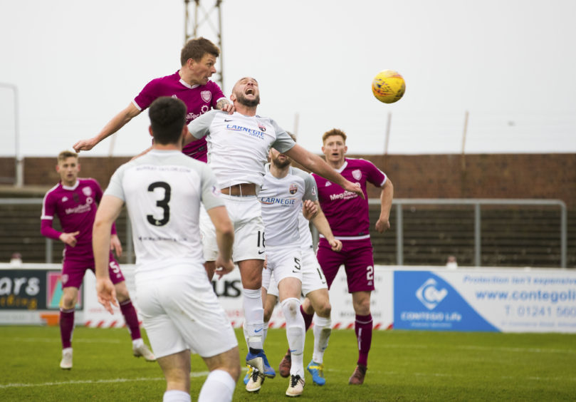 Arbroath's Ricky Little scores the opening goal to make it 1-0