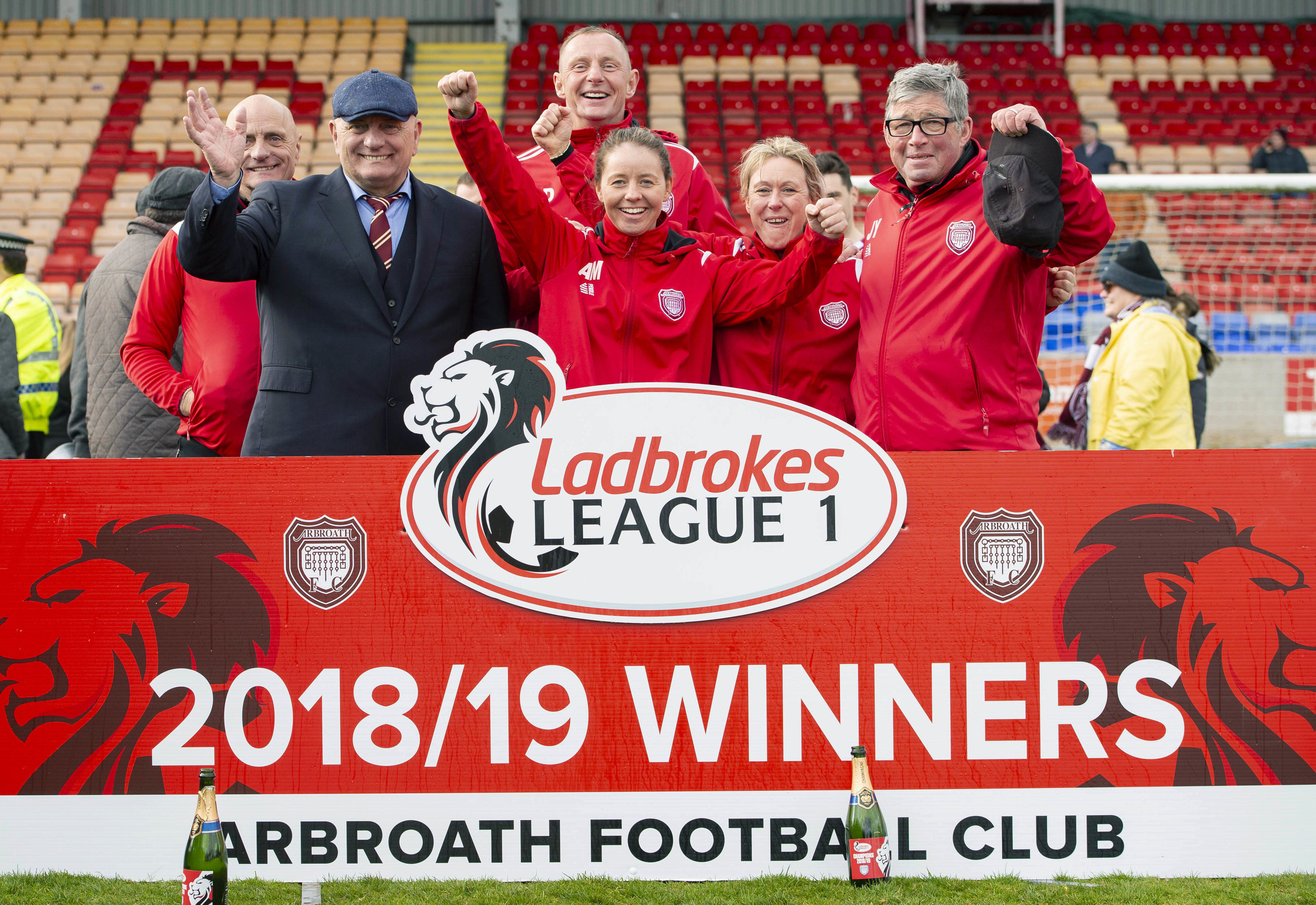 Arbroath manager Dick Campbell and his backroom staff celebrate promotion to the Ladbrokes Championship