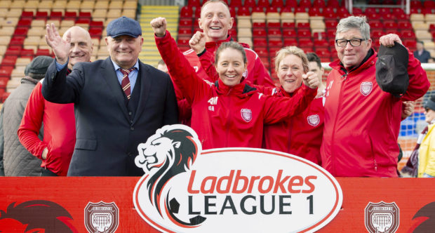 Arbroath manager Dick Campbell and his backroom staff celebrate promotion to the Ladbrokes Championship.