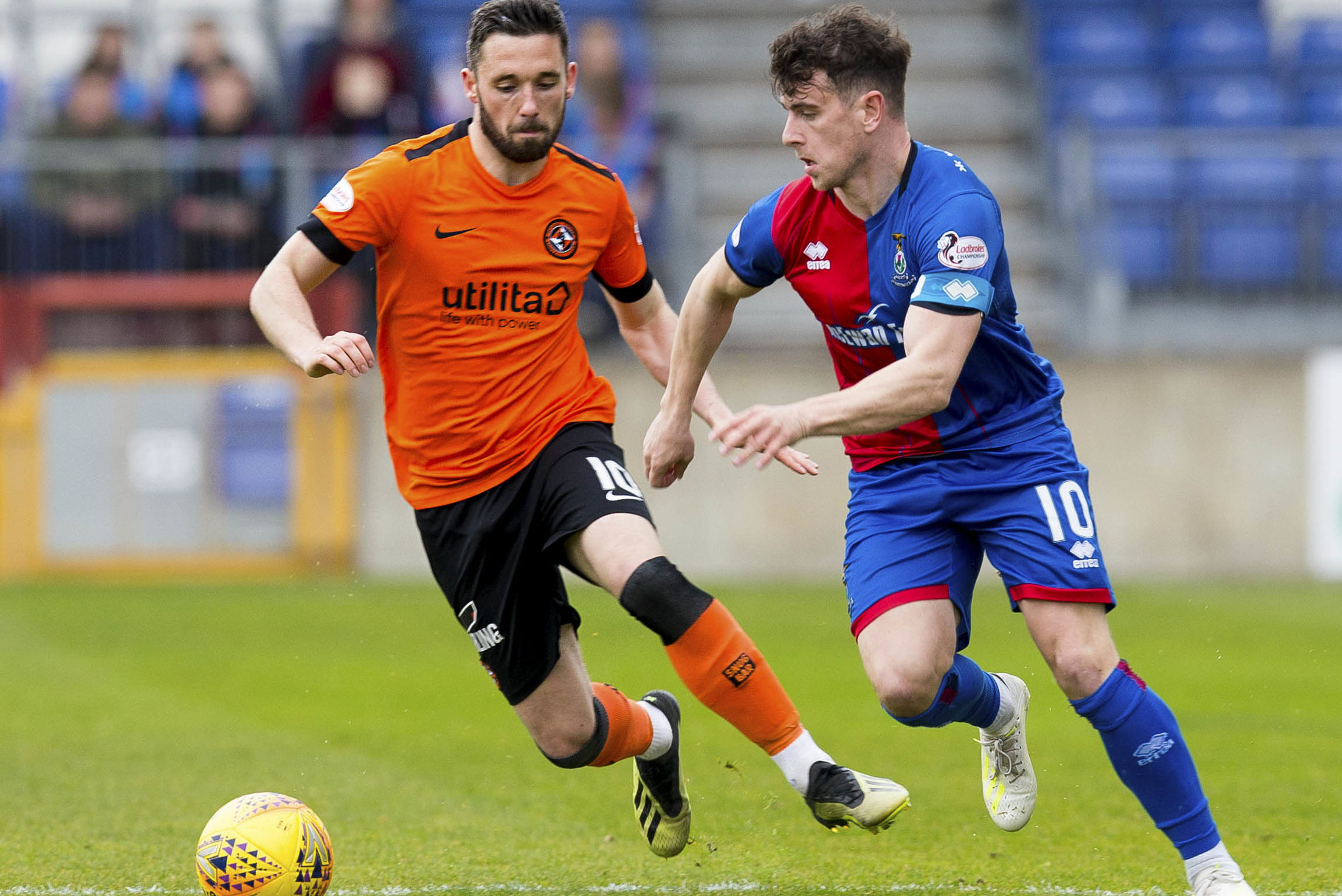 Aaron Doran, right, in action with United frontman Nicky Clark.