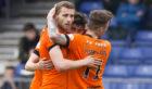 Dundee United's Pavol Safranko celebrates his goal with his teammates.
