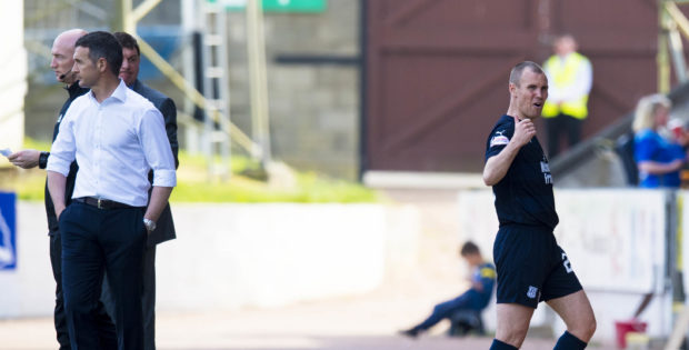Kenny Miller shows his displeasure after being substituted.