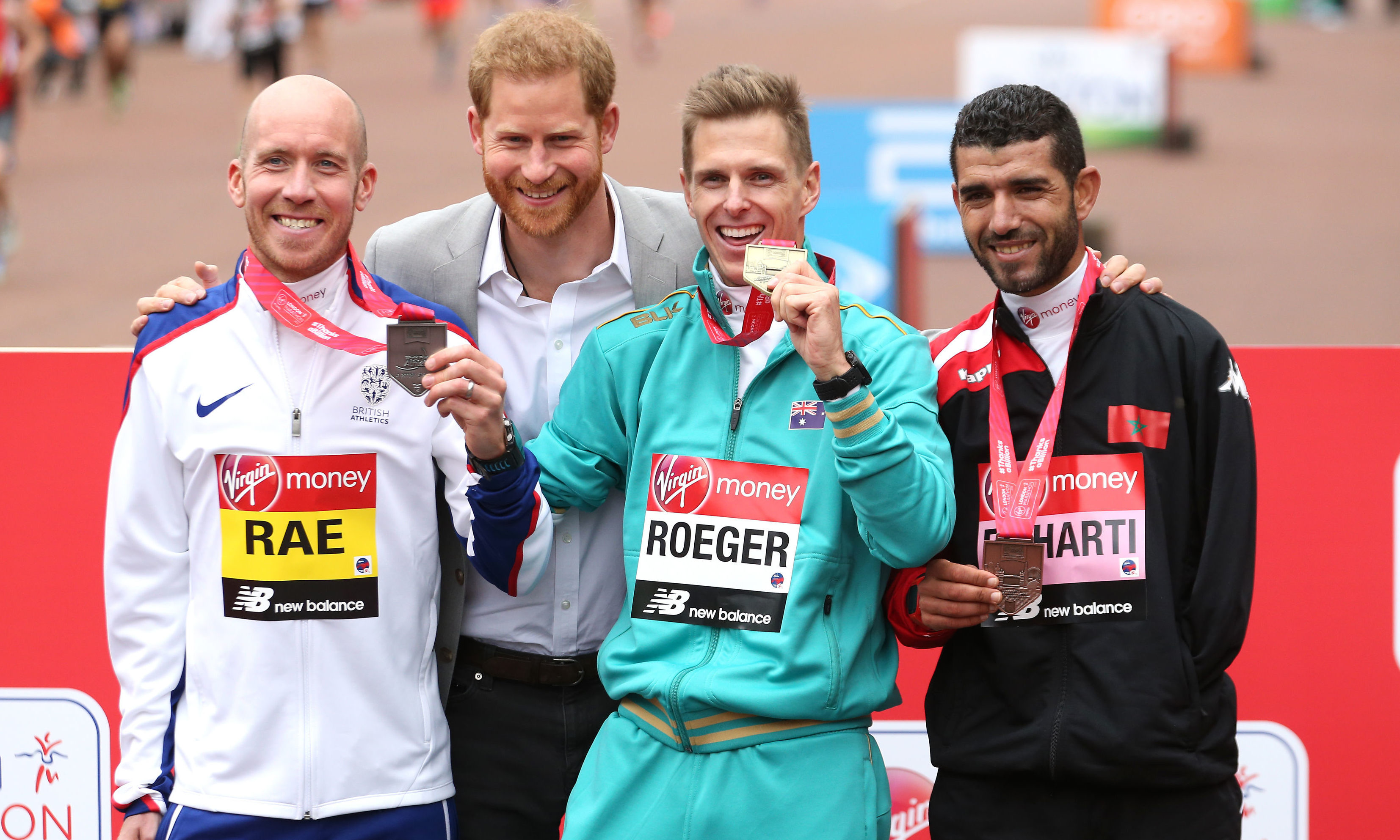 The Duke of Sussex poses for a picture with Great Britain's Derek Rae (left), Australia's Michael Roeger and El Harti (right) after receiving their medals in the WPA Marathon during the 2019 Virgin Money London Marathon.