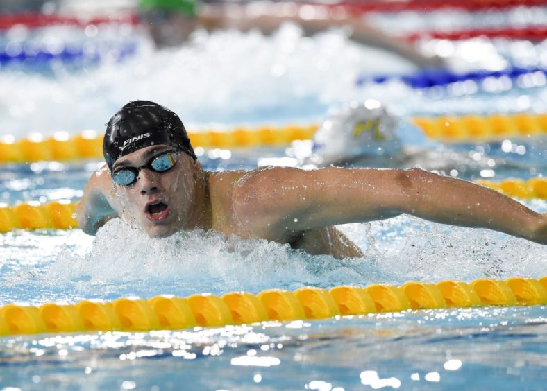 James Guy on his way to winning his heat of the Mens 200m Butterfly.
