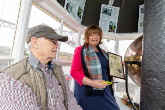 Garry Irvine from North Queensferry Heritage Trust in the 1817 Light Tower with MSP Fiona Hyslop