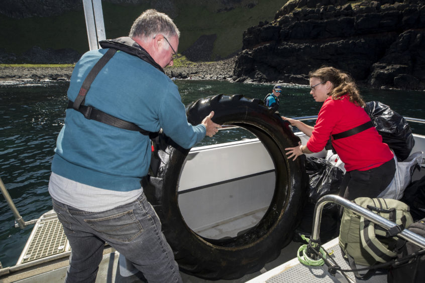 Volunteers load rubbish onto a boat during a litter pick around the coastline of the Giant's Causeway in Northern Ireland. Swimmers, jet skis and small boats all helped to reach bays at the bottom of steep cliffs close to the Unesco World Heritage Site. It was the National Trust's third litter pick at sea in the area which is teeming with wildlife from pods of dolphins to breeding seabirds, porpoises and even the occasional orca.