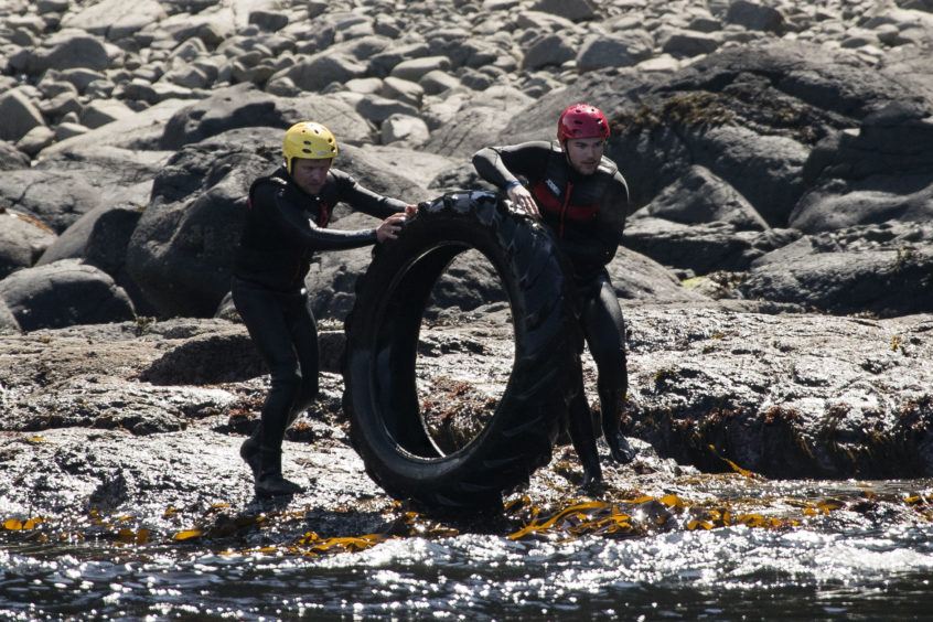 Volunteers help clean up rubbish around the coastline of the Giant's Causeway in Northern Ireland. Swimmers, jet skis and small boats all helped to reach bays at the bottom of steep cliffs close to the Unesco World Heritage Site. It was the National Trust's third litter pick at sea in the area which is teeming with wildlife from pods of dolphins to breeding seabirds, porpoises and even the occasional orca.