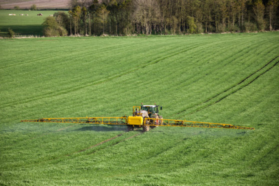 Farmers should consider sharing machinery to cut costs.