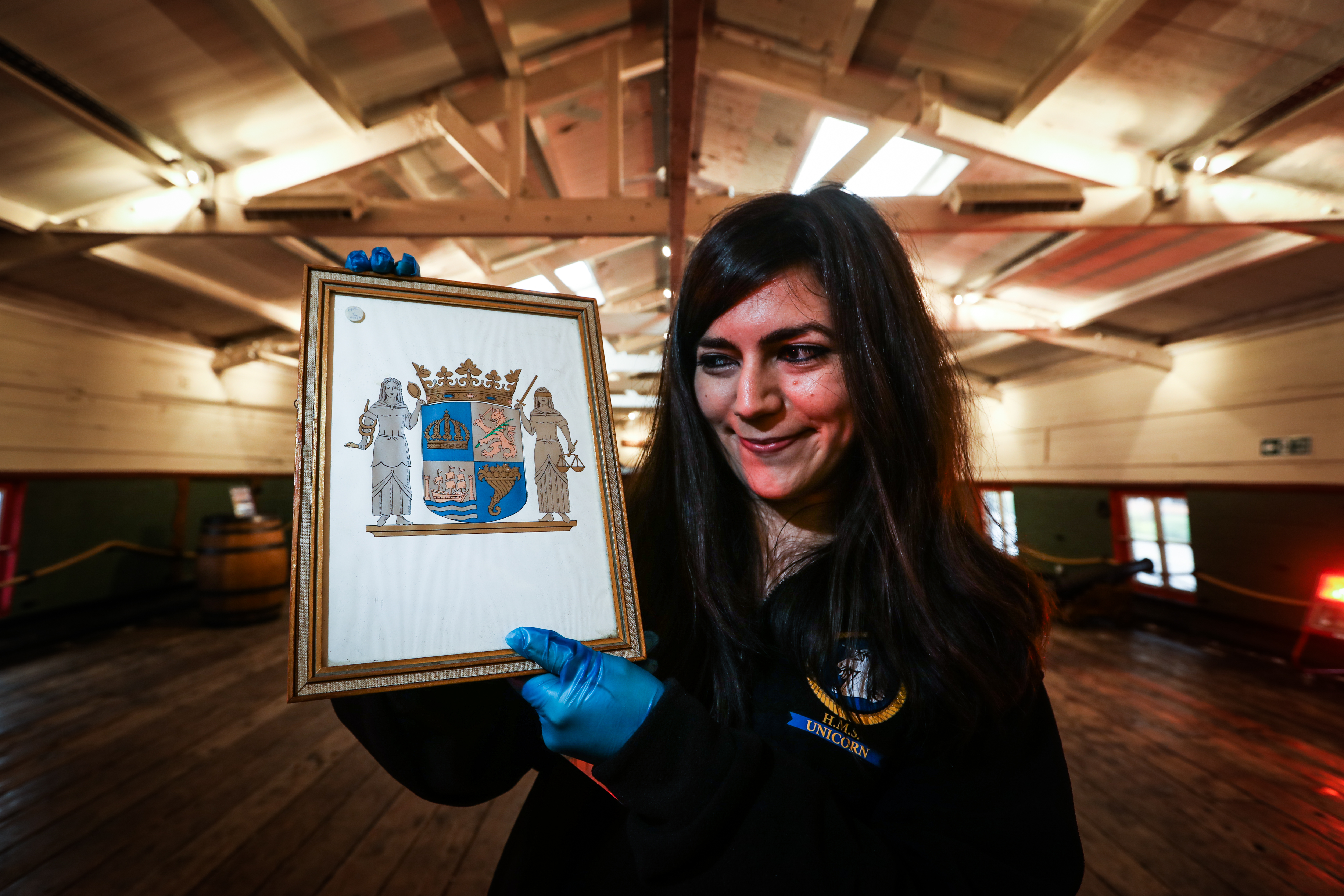 Federica Papiccio, HMS Unicorn's collection officer, with the Swedish coat of arms