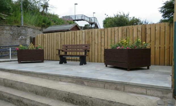 A community seating area with planters was created where the Cardenden shop once stood.