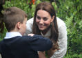 Catherine, Duchess of Cambridge speaks children during a visit to her garden at the RHS Chelsea Flower Show at the Royal Hospital Chelsea .