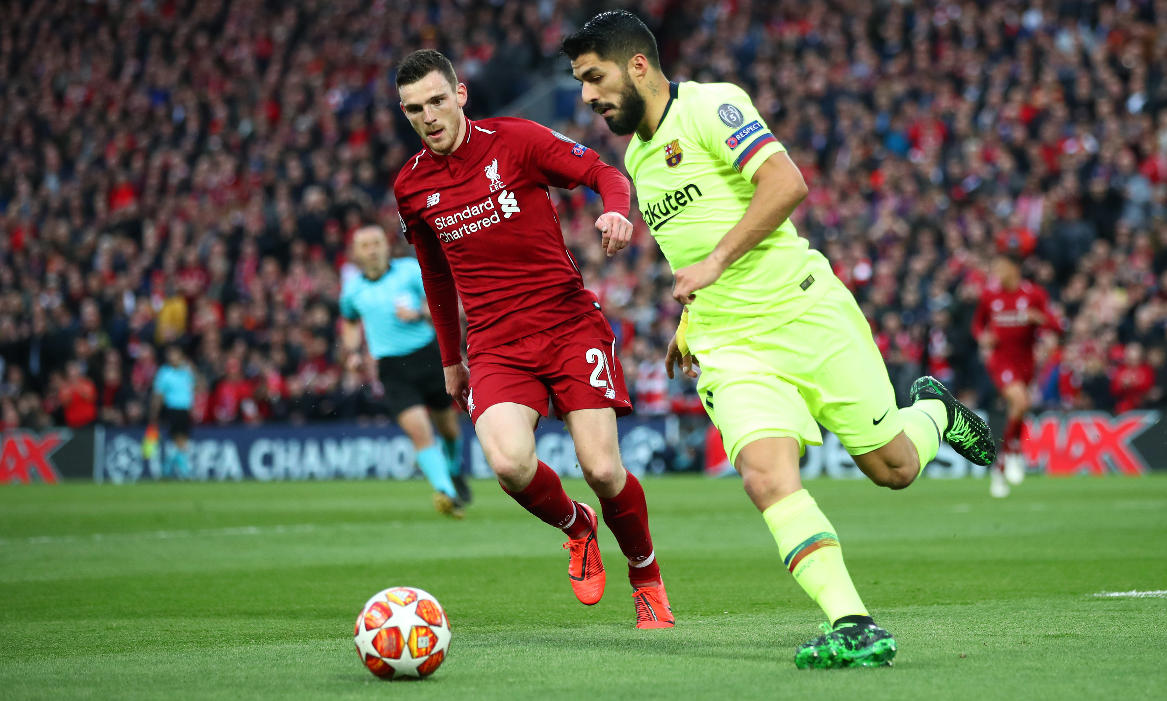 Luis Suarez of Barcelona battles for possession with Andy Robertson of Liverpool during the UEFA Champions League Semi Final second leg match between Liverpool and Barcelona at Anfield.