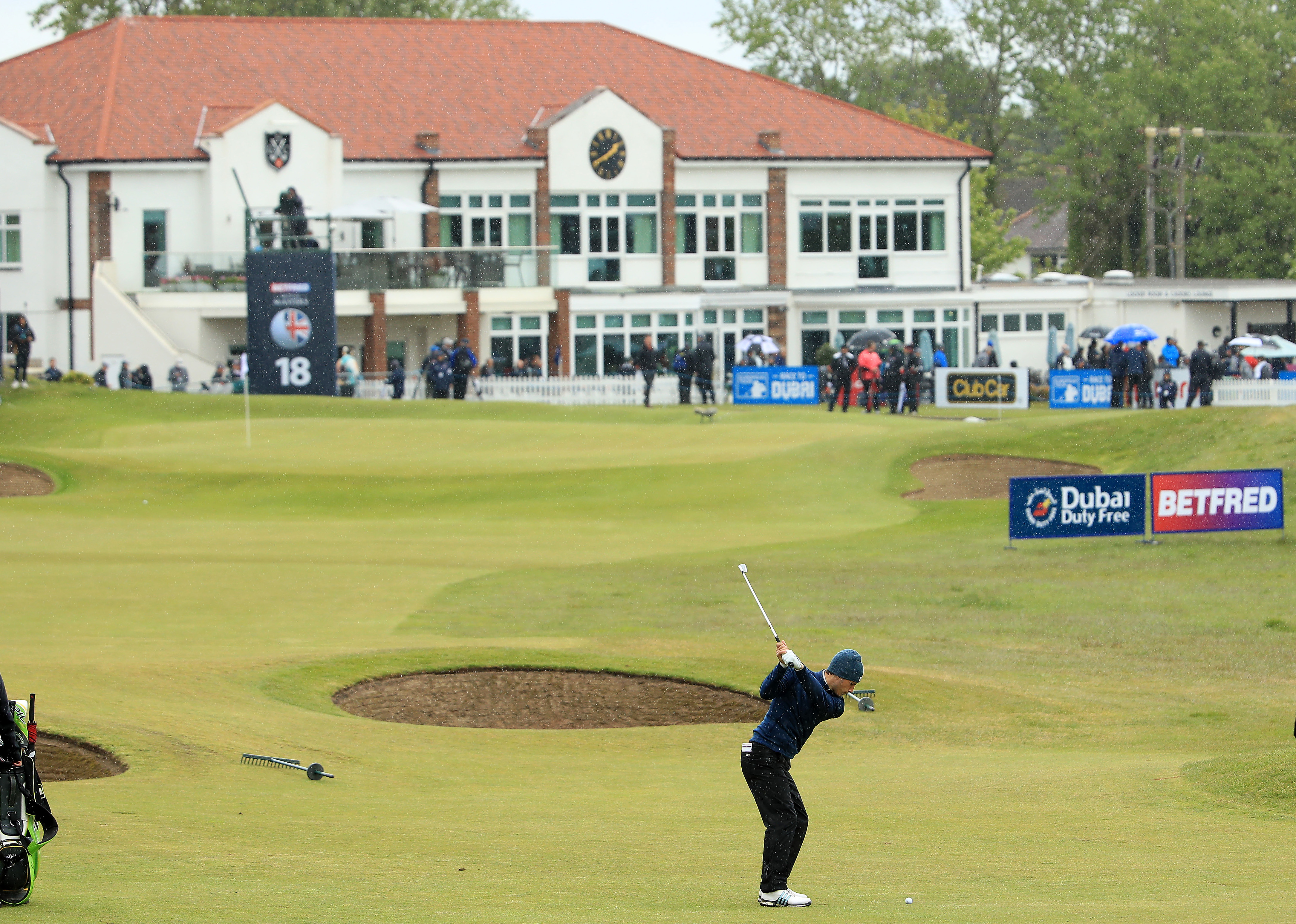 Matthew Jordan hits his approach to the 18th during Day One of the Betfred British Masters at Hillside.