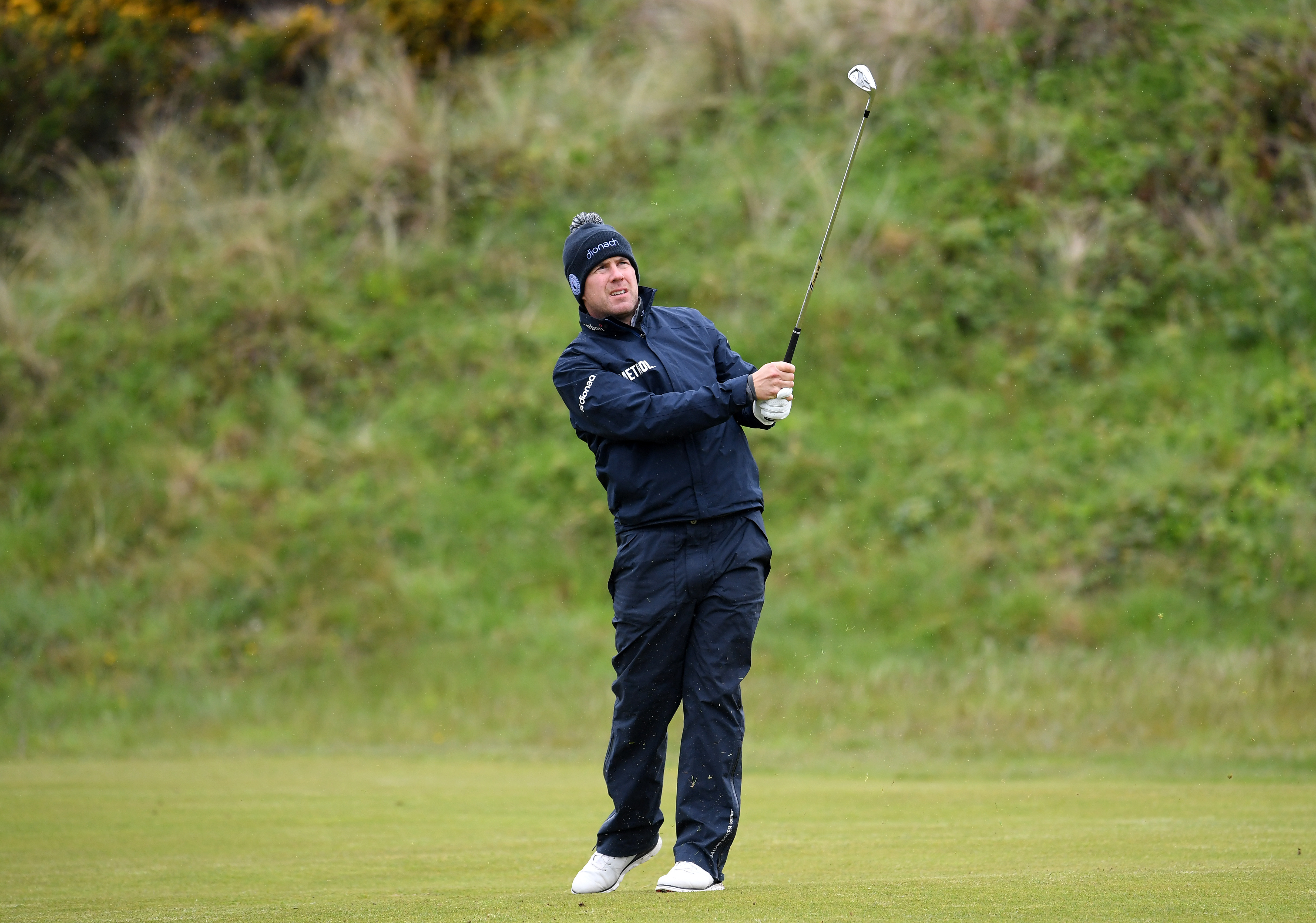 Richie Ramsay plays his 2nd shot on the 8th during Day One of the Betfred British Masters at Hillside Golf Club.