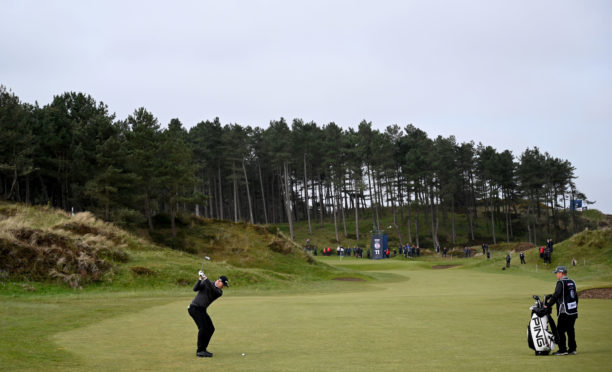 Matt Wallace on the 12th fairway at the Betfred British Masters at Hillside Golf Club.