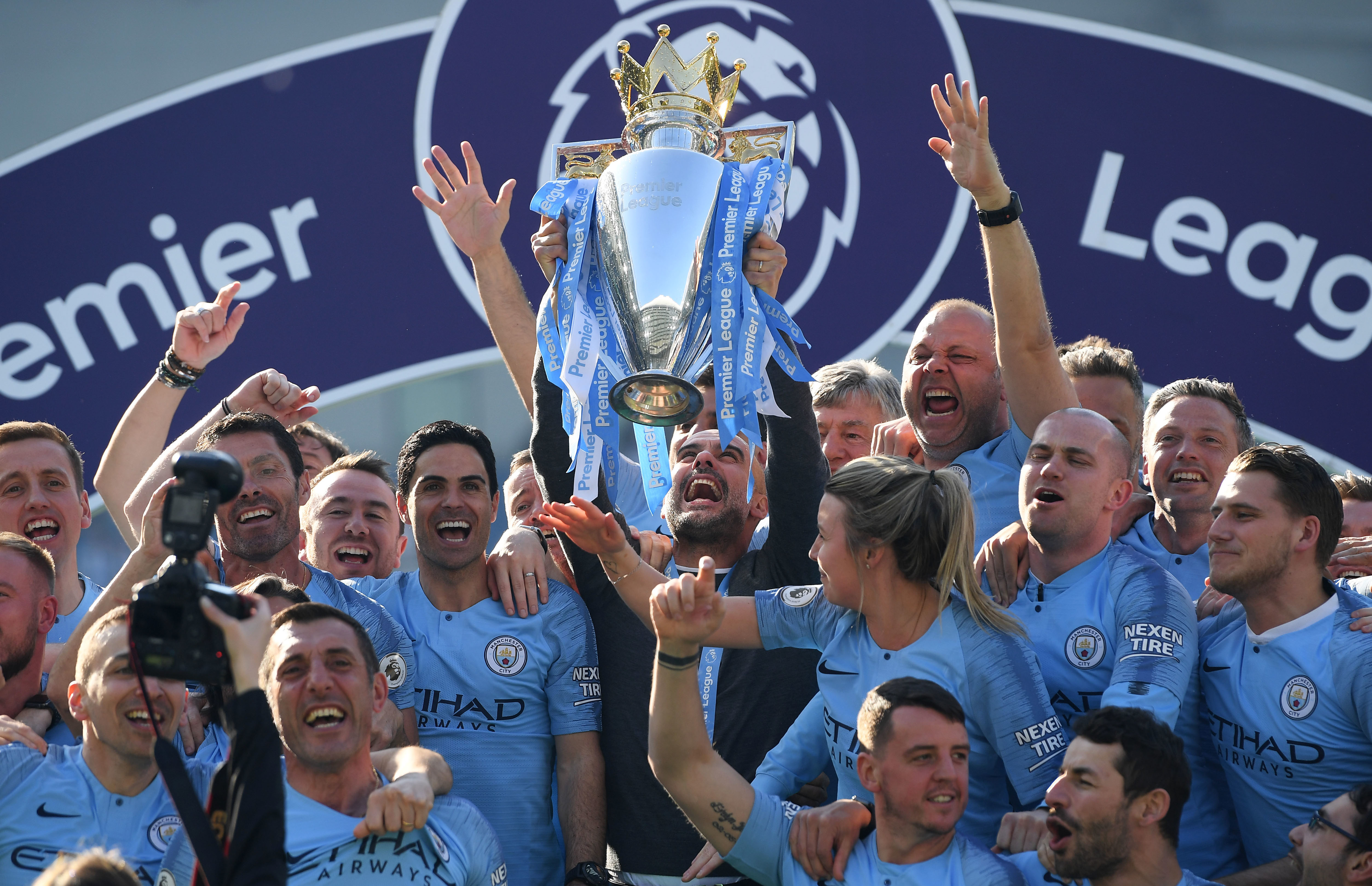 Manchester City manager Pep Guardiola holds the winners' trophy aloft after the Premier League match between Brighton & Hove Albion and Manchester City.