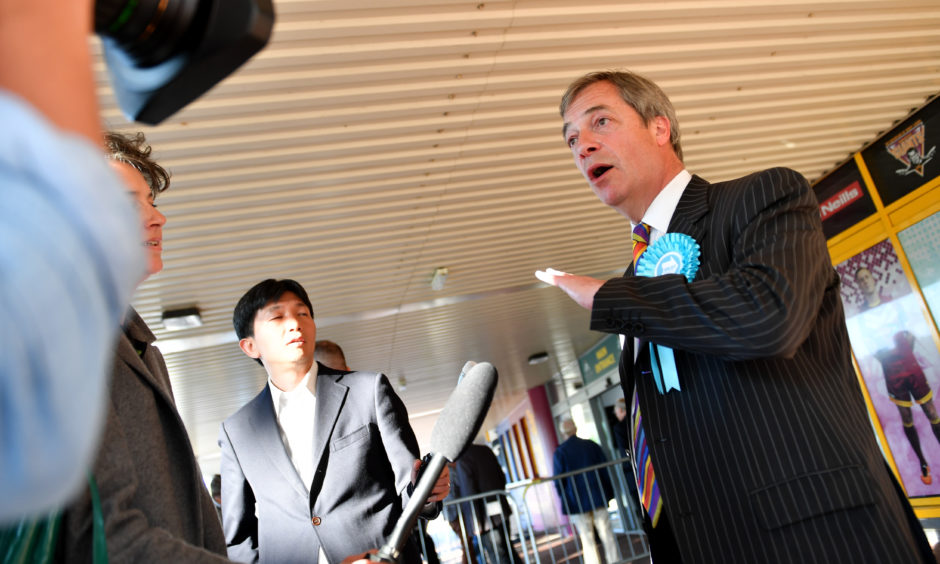 Nigel Farage speaks to media during a Brexit Party rally at the John Smith's Stadium on May 13, 2019 in Huddersfield.