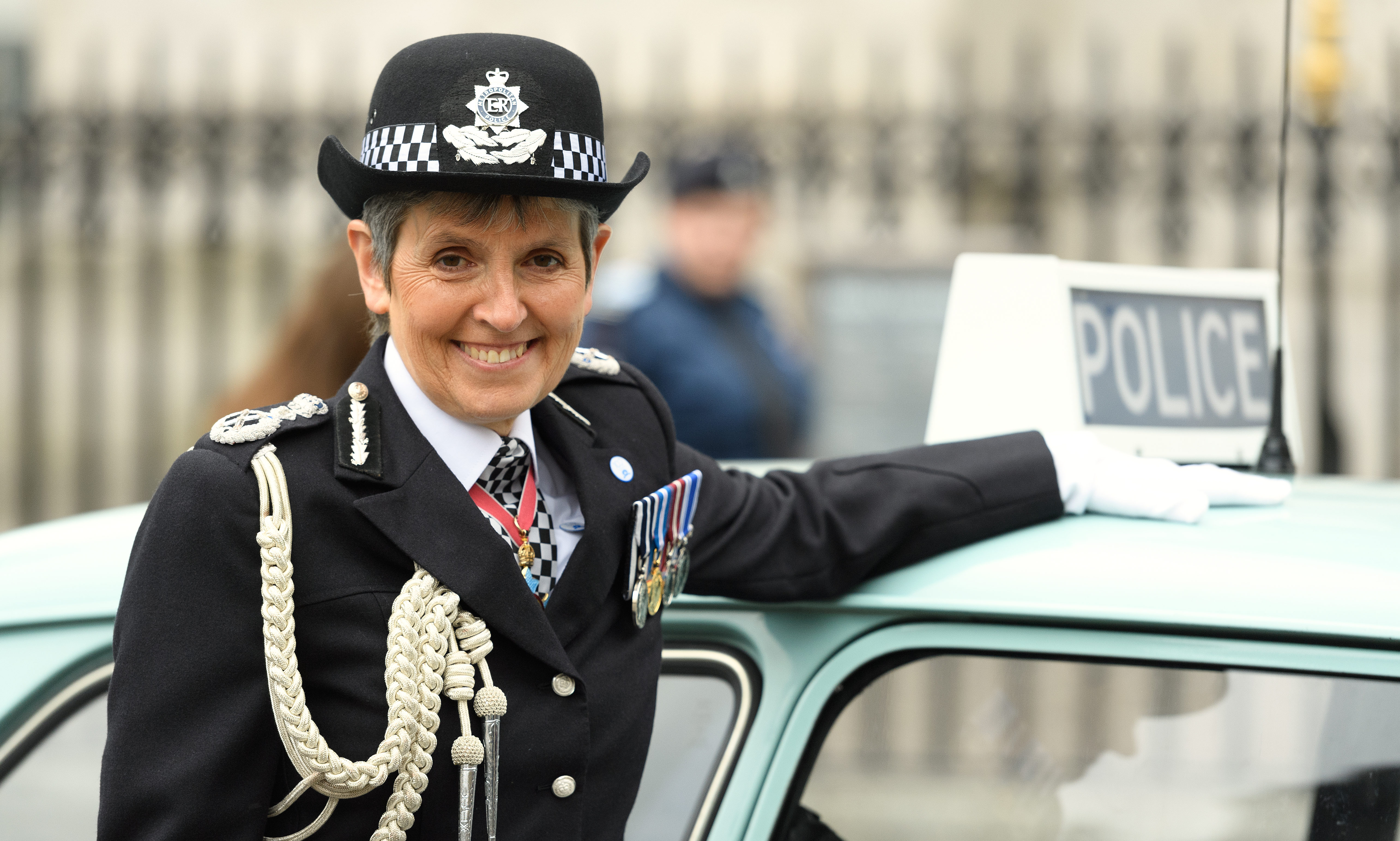 Commissioner of the Metropolitan Police Service Cressida Dick poses with an Austin 1100 police car  at Westminster Abbey.