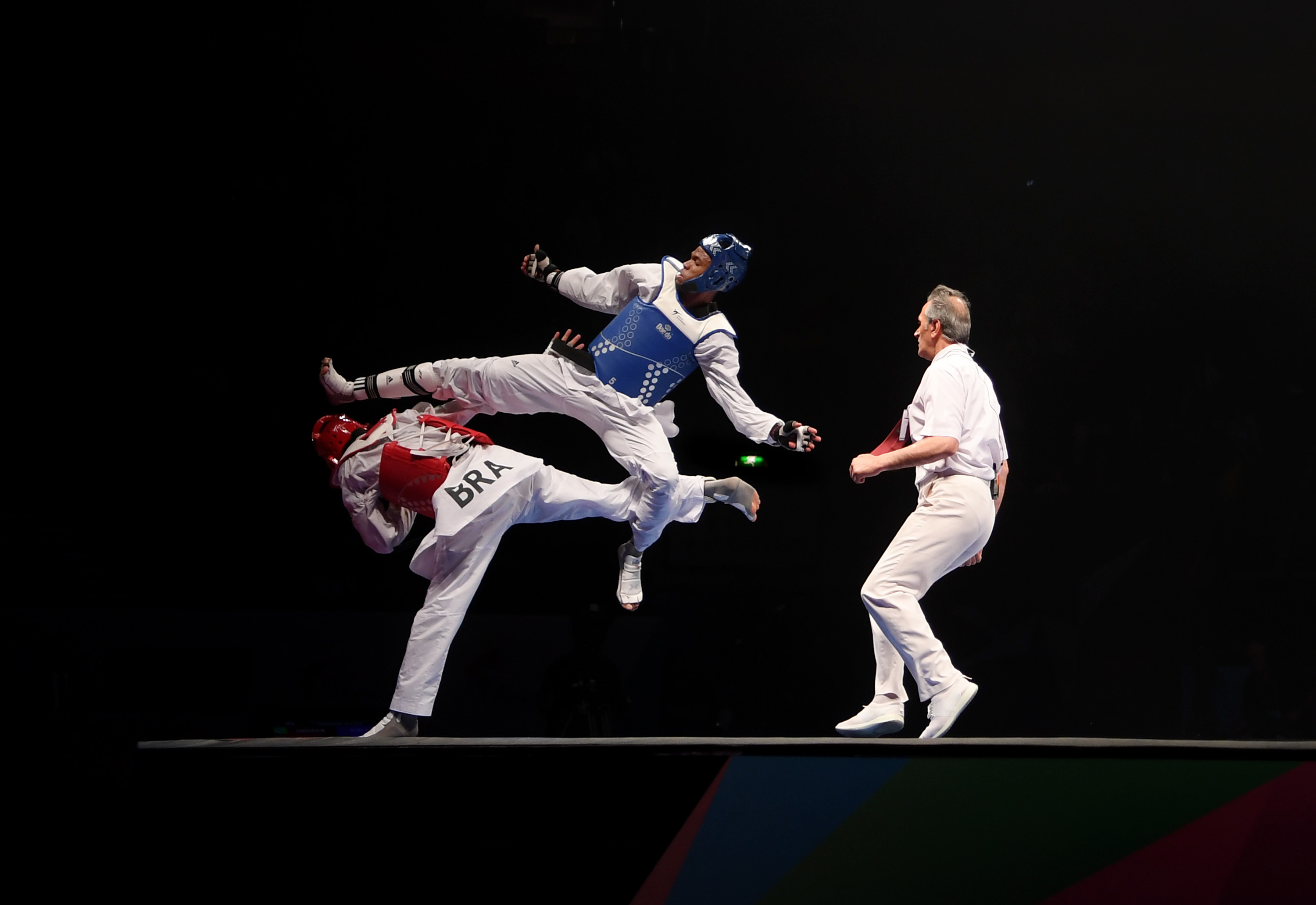 Rafael Alba of Cuba competes against of Maicon Siquera of Brazil in the Semi Final of the Mens +87kg during Day 5 of the World Taekwondo Championships at Manchester Arena .