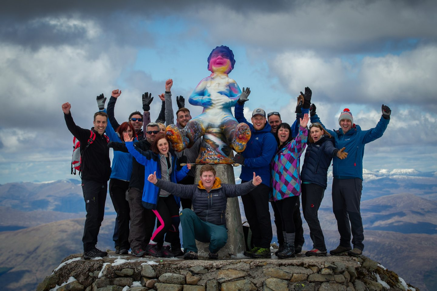 Douglas Roulston, centre, and his support crew celebrating after lifting Oor Nevis to the top of the UK's highest mountain.