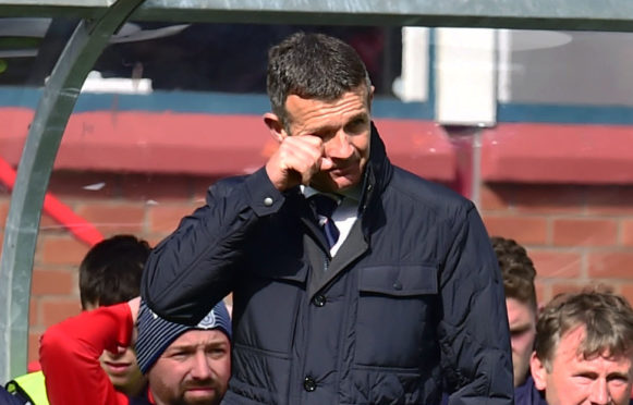 Jim McIntyre watches on as Dundee slump to defeat and relegation.