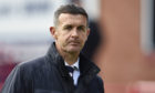Dundee manager Jim McIntyre trudges off the field following relegation from the Ladbrokes Premiership.