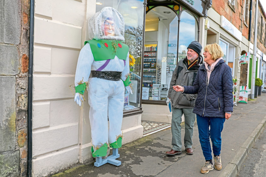 Marjory & Robin Brown from Elie have a chuckle at Buzz Lightyear.