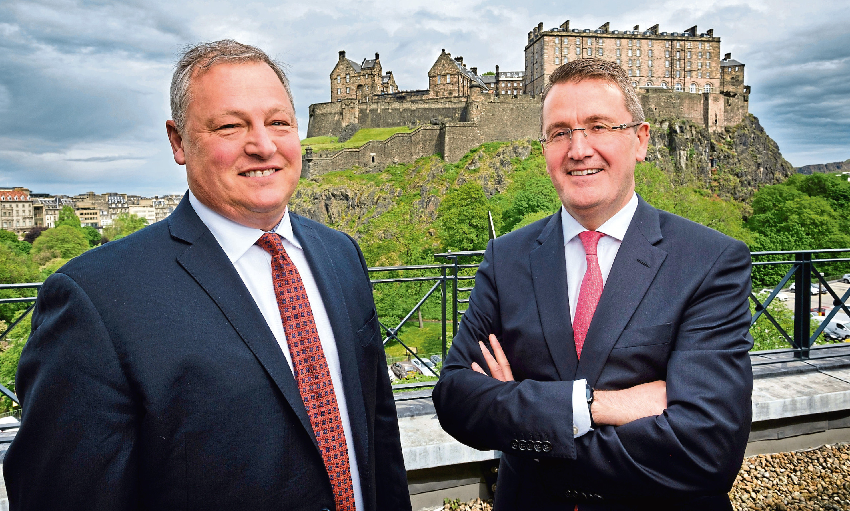 Paul Soubry, president of NFI, with Colin Robertson, chief executive of Alexander Dennis.