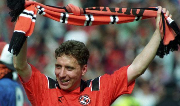 Jim McInally celebrates the cup win.