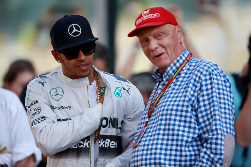 "Mercedes Lewis Hamilton with Niki Lauda during the 2014 Abu Dhabi Grand Prix at the Yas Marina Circuit, Abu Dhabi, United Arab Emirates. Formula 1 racing team McLaren said it was ""deeply saddened"" to learn that three-time world champion driver Niki Lauda had died aged 70."