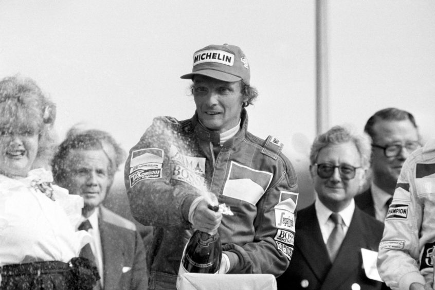"ustrian Niki Lauda celebrating victory in the British Grand Prix at Brands Hatch after winning in his Marlboro McLaren. Formula 1 racing team McLaren said it was ""deeply saddened"" to learn that three-time world champion driver Niki Lauda had died aged 70."