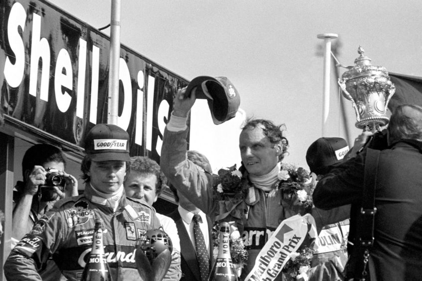 Austrian Niki Lauda celebrates victory in the British Grand Prix at Brands Hatch.