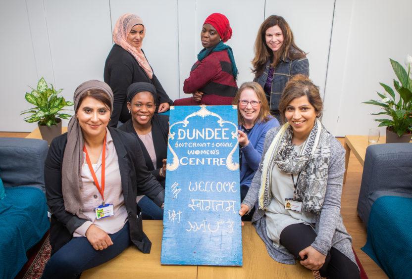 Fatima Ramzan, Mariam Diallo, Susan A'Brook and Vaqar Salimi. Back row, left to right is Nausheen Karim, Diare Drammeh and Beth Morgan at Dundee Internal Women's Centre