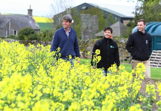 Hugh Black at his Backboath Farm, near Forfar, with rural affairs minister Mairi Gougeon and Zach Reilly, agricultural consultant with SAC Consulting.