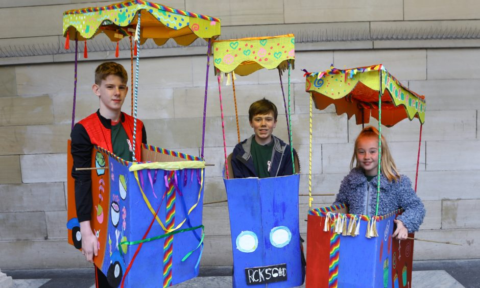 James Kirk, Finn McGregor and Alexie Grant, from the Rocksolid group are ready in their Tuk-Tuks.