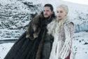 "Kit Harington as Jon Snow, left, and Emilia Clarke as Daenerys Targaryen in a scene from ""Game of Thrones""."