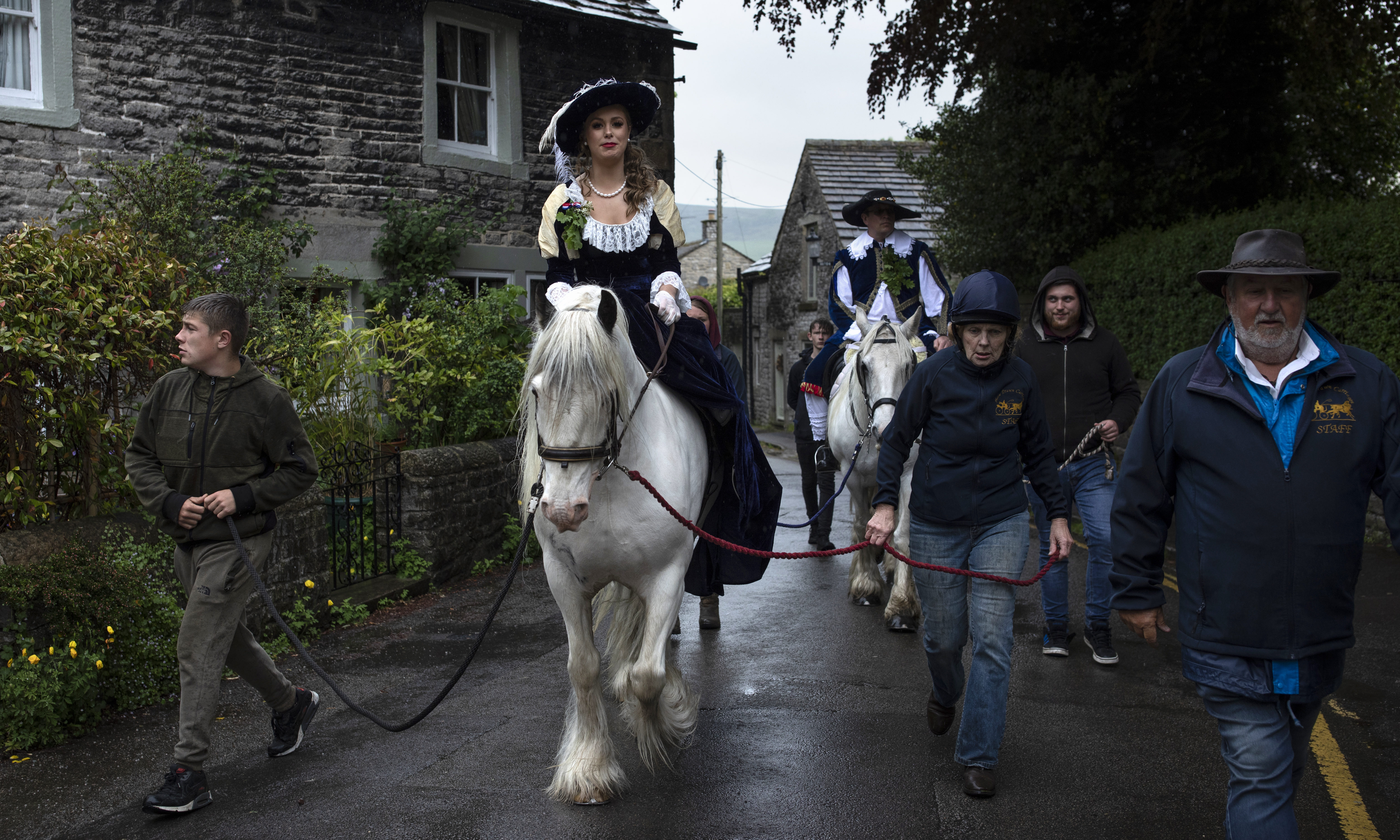 The King and the Queen walk the village bounds during 'Castleton Garland Day'.