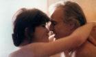 French actress Maria Schneider hugging American actor Marlon Brando in Last Tango in Paris.