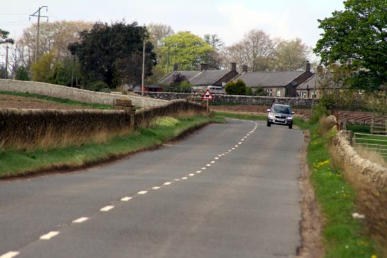 The approach to the cottages on the B9128 Muirdrum to Forfar road.