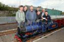 John Kerr of  Kerr's Miniature Railway in Arbroath receives the cheque from Richard Birse, Steven Brykajlo, Jordan Kearney, Derek Hoskins, Guy Houston and Jim Ramsay of Scot-Rail.co.uk